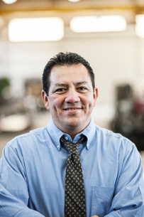Hispanic man manager in a sheet metal factory.の写真素材 [FYI02263868]