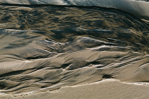 Detail of beach sand and patterns at low tide, Arcadia Beach State Park, Oregonの写真素材 [FYI02263950]