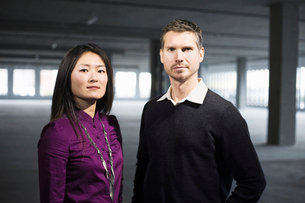 Caucasian male and Asian female business owners in a new raw business space.の写真素材 [FYI02263956]