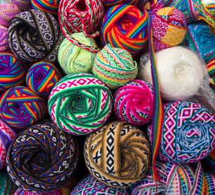 High angle close up of selection of colourful balls of decorative ribbons with geometric patterns.の写真素材 [FYI02263962]