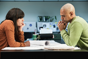 Mixed Race woman and Black man going over a project in their business office.の写真素材 [FYI02263994]