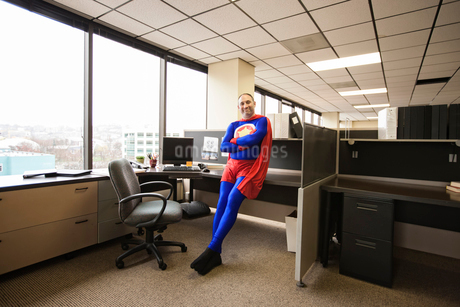 A self satisfied Caucasian office super hero in his office cubicle.の写真素材 [FYI02264067]