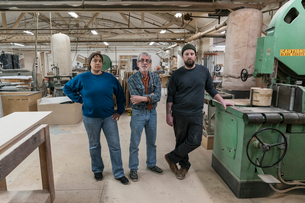 Portrait of a team of three mixed race carpenters in a large woodworking factory.の写真素材 [FYI02264167]