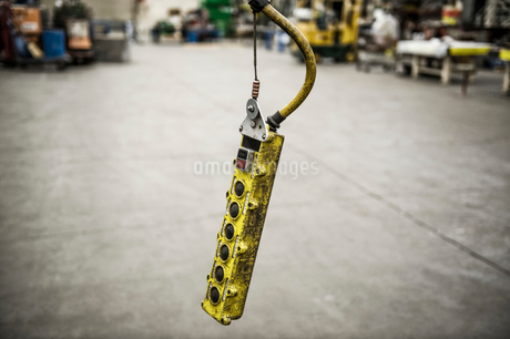 Overhead lift control unit used in a sheet metal factory.の写真素材 [FYI02264207]