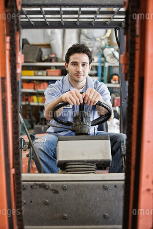 Caucasian man employee driving a forklift for a landscape company.の写真素材 [FYI02264233]