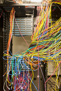 A mess of Cat 5 cables in an office server room.の写真素材 [FYI02264324]