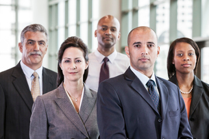 A mixed race group portrait of business people standing in a convention centre lobby.の写真素材 [FYI02264434]