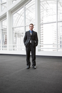 Portrait of a Caucasian businessman at a convention centre space.の写真素材 [FYI02264636]