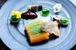 Salmon with smoked beets, cucumber, dill and zucchini blossomの写真素材 [FYI02264729]