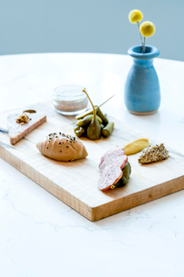 French charcuterie board with pickles, capers and mustardの写真素材 [FYI02264747]