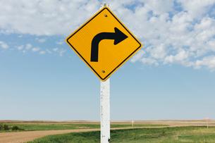 Caution turn ahead sign, near Scotsguard, Saskatchewan, Canada.の写真素材 [FYI02264953]