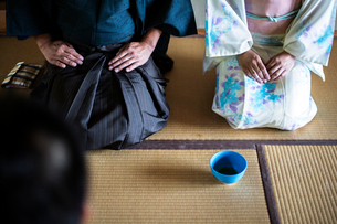 High angle view of Japanese man and woman wearing traditional white kimono with blue floral patternの写真素材 [FYI02265091]