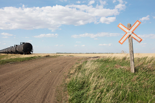 Oil train cars and road crossing, near Swift Current, Saskatchewan, Canada.の写真素材 [FYI02265771]