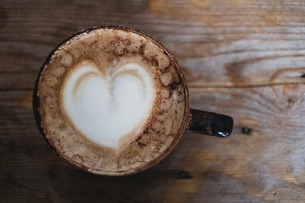 High angle close up of cappuccino topped with foam heart.の写真素材 [FYI02265805]