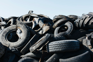 Pile of discarded auto and tractor tires in rural landfil, near Kildeer, Saskatchewan, Canada.の写真素材 [FYI02265808]