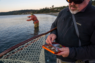 A fly-fishing guide checks his fly assortment for salmon and searun coastal cutthroat trout while hiの写真素材 [FYI02265980]