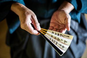 High angle close up of Japanese man wearing kimono holding Sensu fan.の写真素材 [FYI02266023]