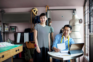 Japanese male and female fashion designers working in a studio.の写真素材 [FYI02266226]