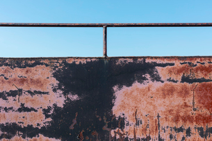Close up of rusty black wall with railing.の写真素材 [FYI02266271]