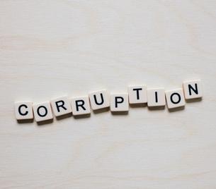 Letter blocks spelling the word CORRUPTIONの写真素材 [FYI02266327]