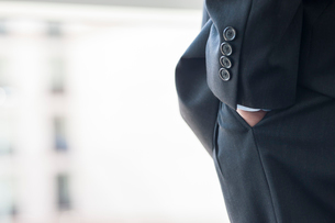 Close-up of a businessman's hand in a suit pants pocket.の写真素材 [FYI02266412]