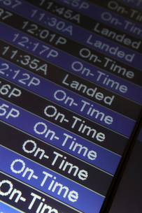 Closeup of a departure schedule sign in an airport.の写真素材 [FYI02266576]