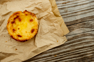 A homemade baked tart on a brown paper bag.の写真素材 [FYI02266606]