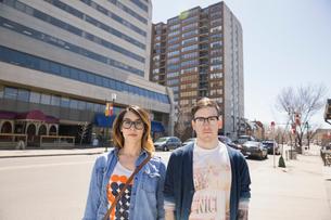Portrait of hipster couple on sunny urban streetの写真素材 [FYI02266795]