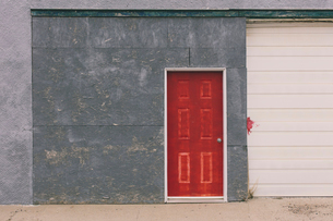 Painted red door and garage exterior, near Robsart, Saskatchewan, Canada.の写真素材 [FYI02266800]
