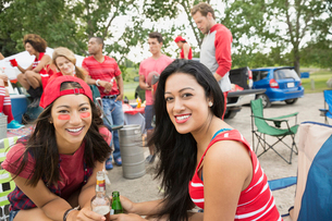 Women smiling at tailgate barbecue in fieldの写真素材 [FYI02268790]