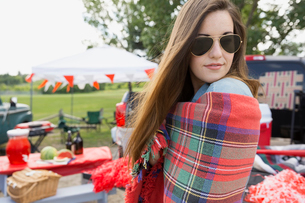 Woman wrapped in blanket at tailgate barbecueの写真素材 [FYI02268956]