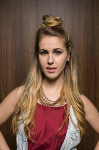 Portrait of serious blonde woman with hair bunの写真素材 [FYI02272042]