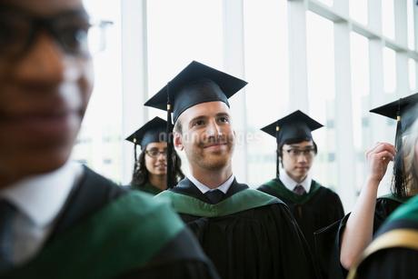 Proud college graduates cap and gown looking awayの写真素材 [FYI02275782]