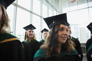 Smiling college graduate in cap and gownの写真素材 [FYI02276003]