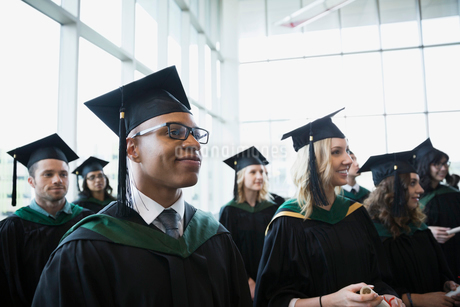 Proud college graduates cap and gown looking awayの写真素材 [FYI02276012]