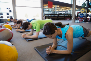 Exercise class holding plank position on mats gymの写真素材 [FYI02276431]