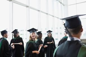 Portrait smiling college graduate in cap and gownの写真素材 [FYI02276742]