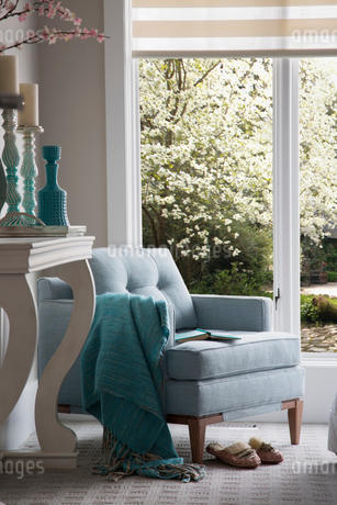 Turquoise decor and armchair by windowの写真素材 [FYI02276872]