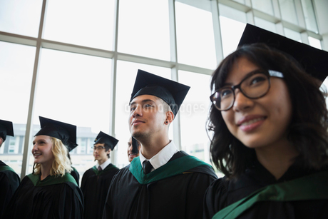 Smiling college graduates in cap and gownの写真素材 [FYI02277254]