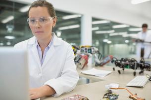 Focused engineer working at computer with roboticsの写真素材 [FYI02281872]