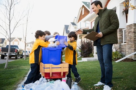 Coach and boys sports team gathering recycling neighborhoodの写真素材 [FYI02283808]