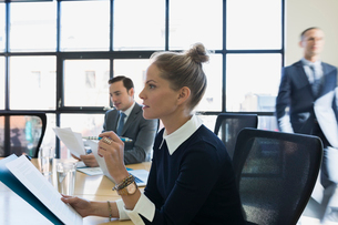 Attentive businesswoman with paperwork in conference room meetingの写真素材 [FYI02285149]