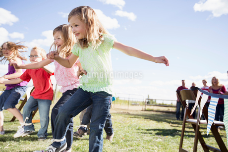 Children competing in 3 legged race at reunion.の写真素材 [FYI02286897]