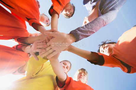 girls soccer team with hand over hand cheerの写真素材 [FYI02287520]