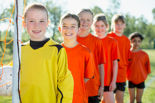 Young female soccer players lined up.の写真素材 [FYI02287627]