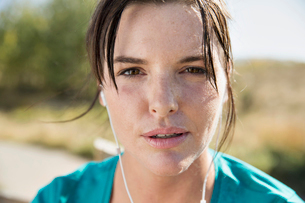 Close-up of woman sweating during outdoor workout.の写真素材 [FYI02287655]