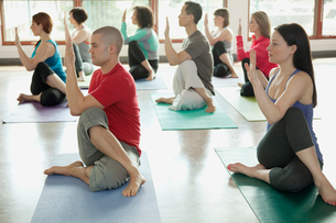Yoga class doing Half Lord of the Fishesの写真素材 [FYI02287961]