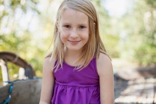 Portrait of cute blond girl in purple shirt.の写真素材 [FYI02289103]