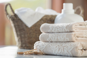 Folded towels with wicker basket and softener.の写真素材 [FYI02289123]