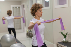 Woman using resistance band for workout.の写真素材 [FYI02289387]